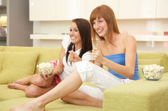 Good game. Two friends in their living room Stock Photo
