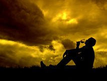 Good glass of wine. Man drinking a glass of italian wine on cloudy sunset royalty free stock images