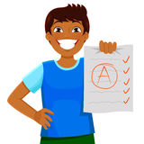 Good grades. Happy kid presenting a test with a good grade Royalty Free Stock Photography
