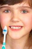 Good habit. Pretty little girl with a tooth-brush Stock Photography
