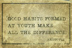 Good habits Aristotle. Good habits formed at youth make all the difference - ancient Greek philosopher Aristotle quote printed on grunge vintage cardboard Royalty Free Stock Photography