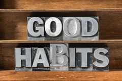 Good habits tray. Good habits phrase made from metallic letterpress type on wooden tray Royalty Free Stock Photos