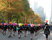 Thanksgiving Day Parade NYC. Marchers in the annual Macys Thanksgiving Day Parade sport wigs of every color Stock Photos