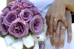 In good hands. Bride and groom hand in hand Royalty Free Stock Images