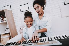 Good and Happy Girl Relax Together. Child and Mom. royalty free stock images