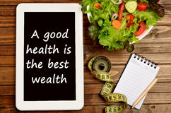 A good health is the best wealth. On tablet pc Stock Images
