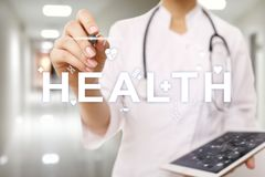 Good health check. Medical doctor using modern virtual screen computer. stock photo