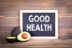 Good health concept. Fitness, healthy eating and veganism. Chalkboard on a wooden background stock photos