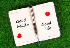 Good health equal good life. Good health and good life word on both sides of the notebook in the concept of equal stock image