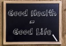 Good Health - good life. New chalkboard with 3D outlined text - on wood stock photos