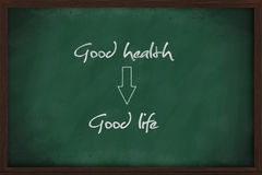 Good health leads to good life. Written on chalkboard royalty free stock photo