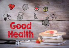 Good Health. Stack of books and a stethoscope on a wooden background Royalty Free Stock Images