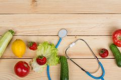 Good Healthy And Diet Concept - Stethoscope And Vegetables, Fruits And Berries On Table Stock Photo