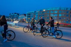 Good holland family on bicycles. 05/27/2016   Hague,  Netherlandes.    Good   holland family  on bicycles. Sportive healthy family and lifestyle. They are stock image