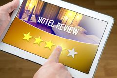 Good hotel review. Satisfied and happy customer. Good hotel review. Satisfied and happy customer giving great rating with tablet on an imaginary criticism site Stock Photography