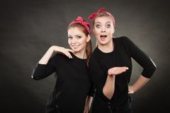 Two funny positive retro styled female portrait. Good humor concept. Retro style and old fashion. Two smiling happy girls in red handkerchief. Women styled on Royalty Free Stock Photo