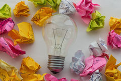 Good idea concept with crumpled colorful paper and light bulb Stock Photo