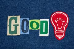 GOOD Idea lightbulb and text word collage, colorful fabric on blue denim, business concept. Horizontal aspect stock photography