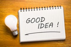 Good Idea. Memo in notebook with light bulb royalty free stock image
