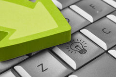 Good ideas background with keyboard, bulb and arrow signal Stock Photo