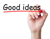 Good ideas. Hand with red marker and Good ideas headline on white background Royalty Free Stock Photos