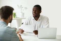 Good impression at job interview concept, hr impressed by resume. Good first impression at job interview concept, excited african hr manager impressed by career royalty free stock images