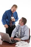 Good job. Two businessmen smiling and discussing work in the office over white Royalty Free Stock Photo