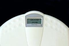 Good job. Weighing machine with GOOD JOB written in the display stock photo