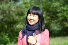 Good job. Pose of cute Chinese girl in summer Royalty Free Stock Images