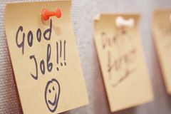 Good job. Adhesive note with Good Job text on a cork bulletin board royalty free stock images