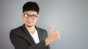 Good job Asian businessman. Asian businessman in black suit stock photo