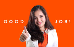 Good Job! A business success. Good Job! Business concept with image of satisfied female executive giving thumb up.  over orange colored background design Stock Photos