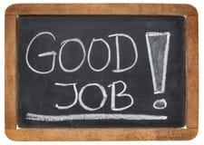 Good job compliment. White chalk handwriting on a vintage slate blackboard stock photography