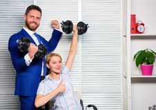 Good job concept. Boss businessman and office manager raise hand with dumbbells. Boost business team. Boost your skill. Man and women raise heavy dumbbells royalty free stock photography