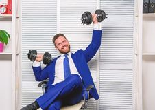 Good job concept. Boss businessman office manager raise hands with dumbbells. Boost business. Boost your managing skill. Man bearded guy raise heavy dumbbells royalty free stock photography