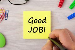 Good Job Exclamation. Handwriting on note with marker pen and various stationery. Business concept stock image