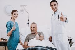 Doctor and Nurse in Clinik. Therapy in Clinic. Good Job in Hospital. Doctor Help Patient. Nurse Help Patient. White Room and Patient. Smail Patient and Doctor royalty free stock image