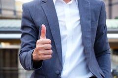 Good job and good man. Good job,good man.Businessman show thumbs up for success business royalty free stock image