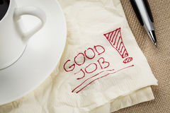 Good job on a napkin. Good job exclamation on a napkin with cup of coffee stock photography