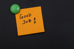 Good job note blackboard. Close up of a post-it note saying good job on blackboard background Royalty Free Stock Photography