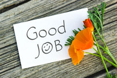 Good job. White card with lettering good job and orange poppy stock image