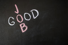 Good Job words written on blackboard over textured wal Royalty Free Stock Images