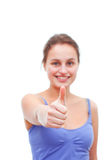 Good Job!! - Young Woman giving thumbs up Royalty Free Stock Image