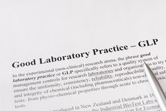 Good laboratory practice or GLP refers to a quality system of management controls for research laboratories Stock Image