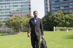 Good looking African American business man in suits, commuting o. Good looking African American business man in suits, photographed in September 2017 Royalty Free Stock Photo