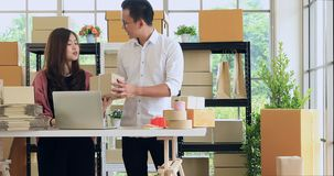 Good looking Asian couple checking product. stock video footage