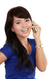 Good looking asian girl talking  on a hand phone. Stock Photo
