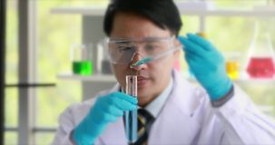 Scientist doing experiment in laboratory. stock footage