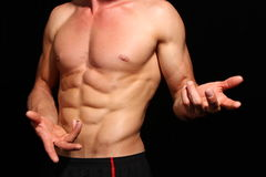 Good looking athlete. Muscular athlete posing on a black background Stock Photo