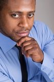 Good looking black man thinking. Royalty Free Stock Images